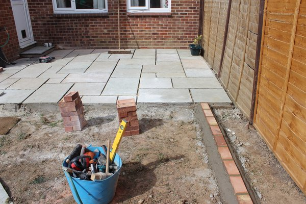 Install low maintenance garden