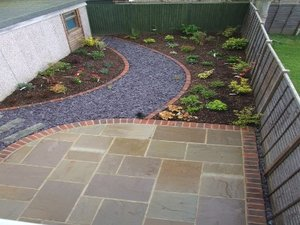 On Off & garden design Patio with curved brick edge and curved chipping path ...