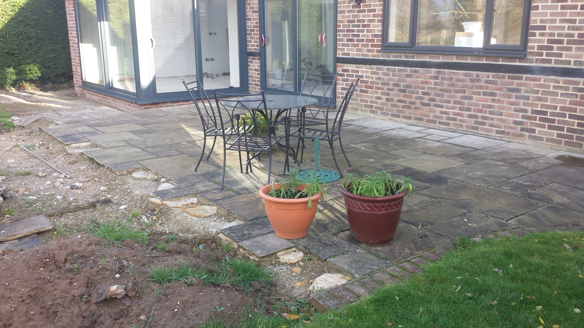 Paving, brick edging and Turf